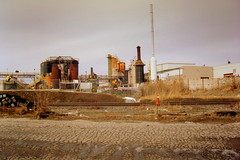 Tar & Shingle Factory (phobexyz) Tags: railroad sky urban plant ontario canada industry grass train concrete industrial factory post decay destruction smoke apocalypse tracks environmental dirty pylon pollution filthy destroyed brampton apocalyptic polluted