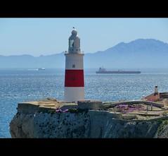 Europa Point lighthouse (fede_gen88) Tags: blue sea lighthouse mist mountains water fog coast spain rocks europe ship northafrica horizon morocco shore gibraltar atlanticocean strait tanker mediterraneansea pillarsofhercules europapoint straitofgibraltar estrechodegibraltar rifmountains greateuropapoint