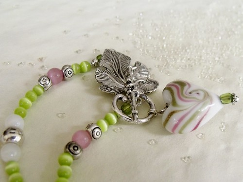 http://www.etsy.com/listing/73659573/romantic-emerald-green-and-pink-lampwork by mSs Distinctive Designs Studio