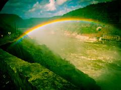 Life is like a rainbow. You need both the sun and the rain to make its colours appear. (legends2k) Tags: bridge water rain clouds lumix rainbow dam roadtrip panasonic g1 blueskies hyderabad anonymous biketrip vibgyor srisailam fourthirds srisailamdam krishnariver microfourthirds panasonicdmcg1