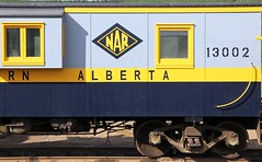 Northern Alberta Railways Caboose 13002 (Laurence's Pictures) Tags: road railroad history train fort rail railway caboose alberta transportation transit ft mcmurray northern railways freight crummy nar waycar