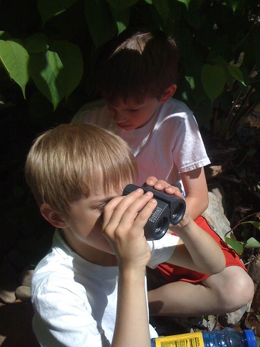 Seth uses my binoculars to look across the river as we hike