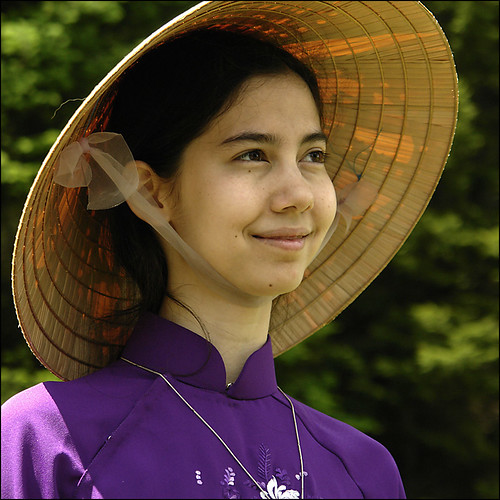 Conical hat and purple Áo dài