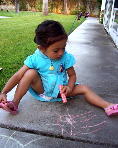 drawing her first chalk sun