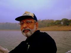 Personality Portrait ??? (ArunaR) Tags: man person boat friend sony colleague aruna malayalikoottam chimmoni