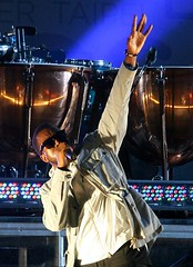 kanye west with his hand inna di air