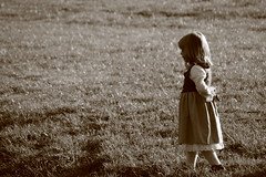 Girl in Traditional Clothing (theowl84) Tags: cute nature girl monochrome grass sepia backlight walking outside austria little traditional young meadow skirt toned styria dirndl tracht styrian 400d canonef55250mmf456is