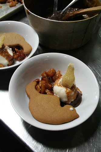 caramelized apples, vanilla soy ice cream, gingerbread kitty cookie and caramel sauce.