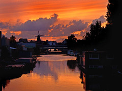 Windmill in Amsterdam Oost (Daveness_98) Tags: sunset orange holland netherlands windmill amsterdam canal zonsondergang nederland molen oranje gracht brouwerij oost brouwerijtij citrit goldstaraward