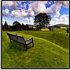 Sit Back and Enjoy The Ride (Nathan Bergeron Photography) Tags: uk clouds geotagged scotland interestingness highlands europe artist aberdeenshire unitedkingdom getty parkbench rollinghills picks haveaseat blueribbonwinner kildrummy explored lonelybench yearinfrance lonebench northandgrampian 18122009 geo:lat=57238145 geo:lon=2881851