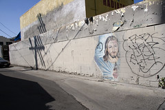 Alley Jesus (susan catherine) Tags: shadow losangeles peeling paint jesus tagging citysurprises