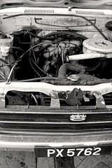 Under The Bonnet (sev-eleven) Tags: car blackwhite streetphotography canoneos350ddigital