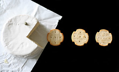 Pac-Man (Camembert Style!) (RR) Tags: food playing art cheese work for with comida humor will queijo pacman need cracker job crackers fromage camembert caper playingwithfood onblack black white alcaparra partofthe spreadhumorcoalition brincandocomacomidablog