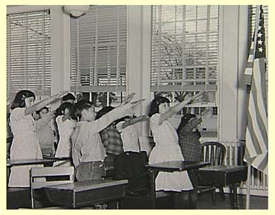 Saluting the flag during the Pledge of Allegiance