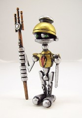 The Littlest Centurion Robot with Laser Trident Wood Figure Sculpture (Builders Studio) Tags: wood fiction sculpture rome cute art classic statue metal trek toy soldier gold was star robot ancient punk comic technology geek mechanical tech little roman metallic space painted helmet cartoon machine artificial science retro steam nasa replica armor ia figure scifi laser nervous pulp wars figurine android prop mecha droid geekery bot mech gladiator robo automaton steampunk trident robotic cyclon