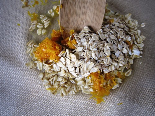 Mixing orange zest and oats