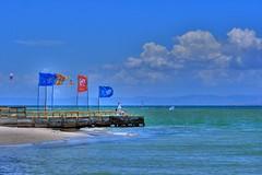 Little dock, Big clouds (jmven) Tags: blue sky cloud beach canon rebel dock playa el cielo margarita hdr yaque mosquera xti goldstaraward