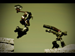 This is CYBERTRON! (revlimit) Tags: sepia toys prime jump nikon gun explore transformers axe optimus animated vivitar processed megatron 43 d300 135mm28 plastic52 300scenerecreation ignorethecrappyhaloaroundthetoys andmanythankstomydarlingwife whoassistedinprimespose