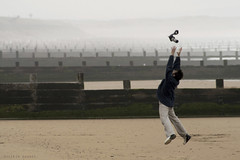 Catch me whenever I fall (Hossein Ghodsi) Tags: camera wood uk slr fall beach fog danger lens photography scotland persian jump jumping hugging sand background just aberdeen catching catch fade iranian curve grab hamed hossein intheair divider irani aberdeenbeach ghodsi masoumi hamedmasoumi catchmewheneverifall hosseinghodsi