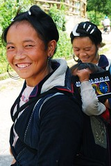 Black H'mong Mother (mowdee) Tags: black smile cat asian nikon village child faces mother nini vietnam wrinkles sapa hmong d40x