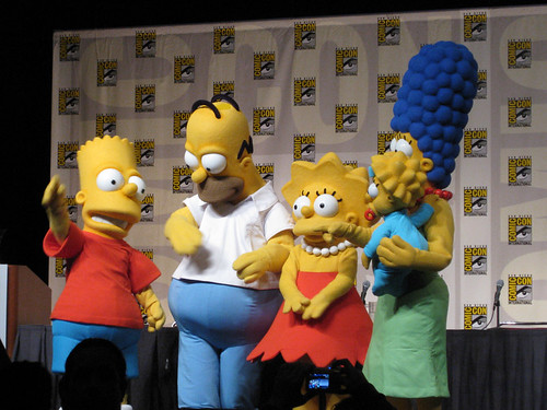 The Simpsons dancing on stage