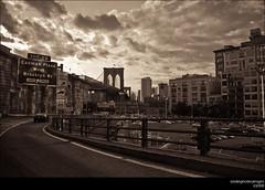 The Brooklyn Bridge From The BQE (A - Lo Photo) Tags: road bridge car sepia brooklyn clouds nikon monotone longisland queens brooklynbridge gothamist expressway lightroom d80