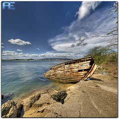 A lost soul... (Ryan Eng) Tags: ocean sea abandoned water clouds hawaii harbor