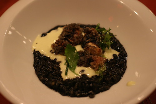 Sepia in squid ink oatmeal and risotto