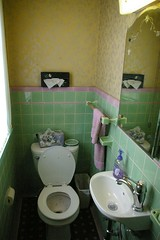 Purple and green tile bathroom