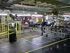 nummi62 Toyota Tacoma Assembly at NUMMI, Fremont CA 2000 (CanadaGood) Tags: california ca usa white color colour building industry yellow america truck work 2000 factory pickup fremont toyota vehicle tacoma generalmotors 2000s nummi canadagood newunitedmotors