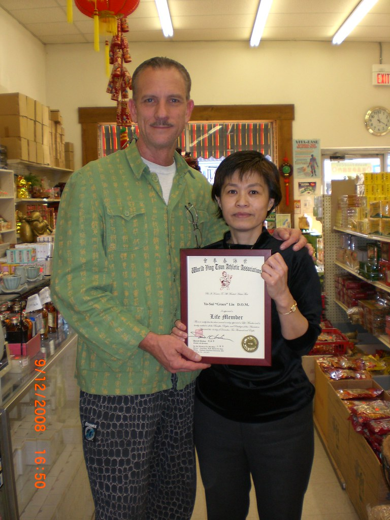 Dr. Ya-Sui (Grace) Lin receiving WVTAA Membership.