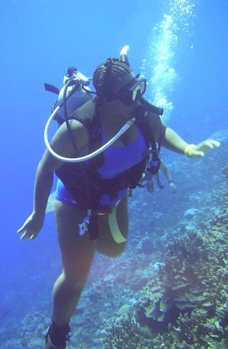 A BBW black woman diving 60 feet under water