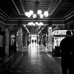 Dark Disney : The Arcade of Time (Gilderic Photography) Tags: door trip travel light shadow vacation people bw white cinema black paris france reflection lamp silhouette architecture canon dark square fun eos europe raw noir mood darkness time disneyland arcade perspective entrance tunnel disney nb ombre ceiling resort story reflet illusion lumiere porte column passage temps cinematic parc blanc contrejour attraction perk plafond lightroom entree carre 500d 500x500 gilderic kisoque