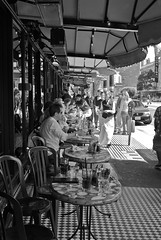 Sidewalk dining (tychay) Tags: sanfrancisco california street camera people northerncalifornia lens outdoors restaurant day unitedstates time eating streetphotography places equipment sidewalk northbeach bayarea actions postprocessing appleaperture leicam8 photospecs voigtlandernokton35mmf12aspherical cvnokton35mm12 voigtlandernokton35mmf12aspherical cosinavoigtlander descriptiveplaces rawfinetuningadjustment straightenadjustment appleaperture20 highlightsshadowsadjustment monochromemixeradjustment sharpenadjustment