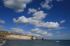 Natural blues - Freshwater Bay, Isle of Wight (s0ulsurfing) Tags: ocean blue light sea sky cliff cloud sunlight seascape beach nature water rock clouds island bay coast rocks raw skies natural bright wide shoreline blues wideangle cliffs coastal shore vectis isleofwight cumulus coastline humilis 2008 isle wight freshwater westwight 10mm freshwaterbay sigma1020 sooc s0ulsurfing straightoutofcamera cumulushumilis welcomeuk