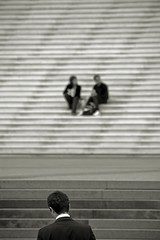 Sinking (Pensiero) Tags: blackandwhite man paris scale stairs women sink ladefense uomo backwards donne portfolio sinking parigi exb affondare