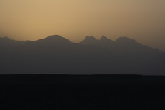 Sunset, Dasht-e Lut Desert, Iran (Rowan Castle) Tags: travel sunset mountains canon eos asia desert iran middleeast persia iranian dslr 2008 img5530 xti dashtelut 400d kaluts ef24105mmf4lisusmlens