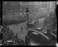 Tanks on parade in London at the end of World War I, 1918 (National Library NZ on The Commons) Tags: bw building london tank military wwi crowd parade worldwari 1910s lightpost firstworldwar crowds tanks 1918 driveslowly thegreatwar markvtank nationallibrarynz armoredwarfare whippettank commons:event=commonground2009 armouredwarfare