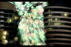 skygasm #2 (mugley) Tags: city urban architecture modern night digital buildings lights nikon apartments skyscrapers fireworks bokeh kitlens newquay australia melbourne victoria docklands nikkor dslr nocturne urbanlandscape palladio d300 55200mmf456gvr minorcrop focusfucting