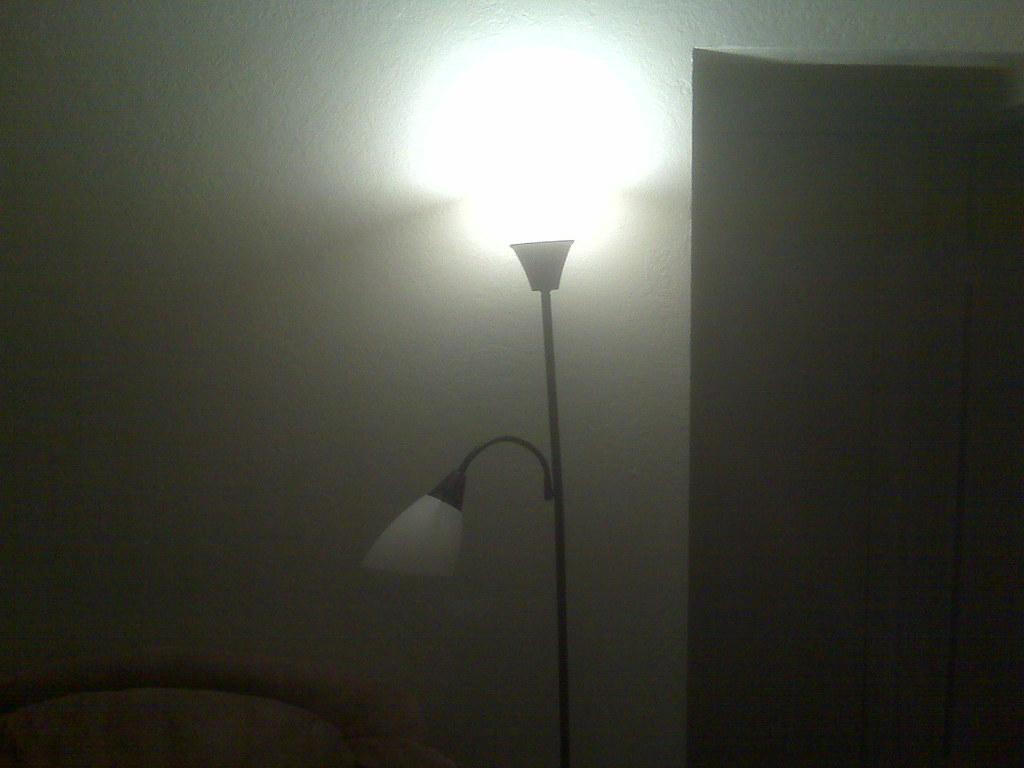 Hideous black plastic floor lamps