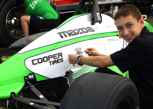 USF2000 driver Zach Veach affixes his new decal for Milwaukee