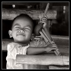 Happiness is easy! (SLpixeLS) Tags: boy portrait blackandwhite bw children thailand kid asia little noiretblanc joy karen thalande chiangmai asie enfant soe joie garon hilltribe warmtone tribu bwemotions mywinners abigfave isawyoufirst platinumheartaward goldstaraward tonschauds earthasia