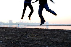 Jumping (Stephanie Town) Tags: lake toronto ontario canada beach water june sunrise jump cntower 2008