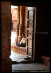 The Boy at the Door (designldg) Tags: door boy people india heritage asia fatehpursikri contrejour uttarpradesh  saarc indiasong articulateimages