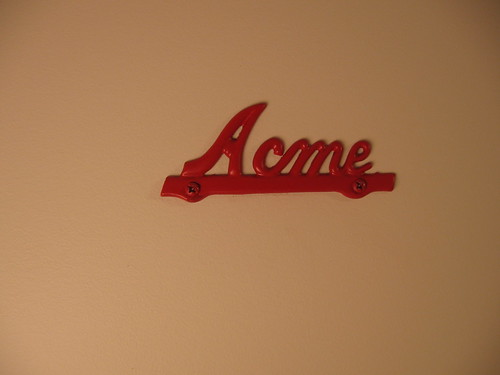 Acme sign on washroom door