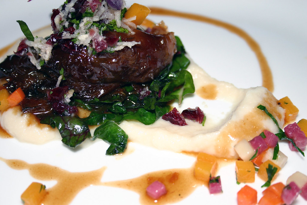 braised lamb shank with cauliflower puree swiss chard glazed root
