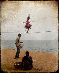 la Saltimbanque Rose (Rick Elkins) Tags: family pink india france beach water girl sand bravo drum acrobat balance performer tamilnadu pondicherry themoulinrouge blueribbonwinner bengalsea photographia fineartphotos mywinners puducherry platinumphoto superaplus aplusphoto goldenphotographer thetempleofaphrodite rickelkins