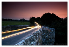 (Claire Hutton) Tags: road uk longexposure bridge sunset england motion southwest field car silhouette night dark lights movement traffic south nighttime filter dorset slowshutter lighttrails wimborne slowshutterspeed riverstour whitemill sturminstermarshall cokingradnd whitemillbridge charboroughtower