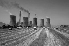 Harvesting Power (Akis Kev) Tags: blackandwhite bw cloud white plant black monochrome field landscape smog europe industrial power wheat smoke harvest greece macedonia pollution dimitrios agios kozani flickrsmasterpieces industrialclouds