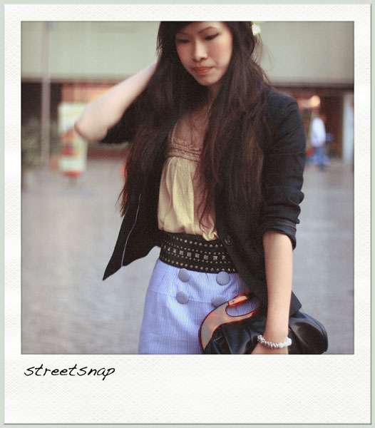 snapshot in the street of Singapore, young fashion lady